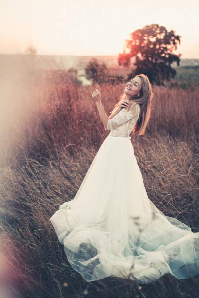 Woman bride in a wedding dress stock photo