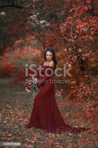 1054970060 istock photo Woman bride with bouquet of flowers 1205053580