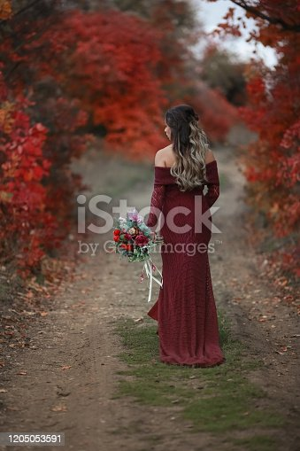 1054970060 istock photo Woman bride with bouquet of flowers 1205053591