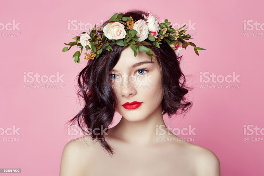 570fa94e87e Woman bright summer look beautiful clothes. Flowers wreath on head. Brunette  girl posing and smiling on bright pink background.