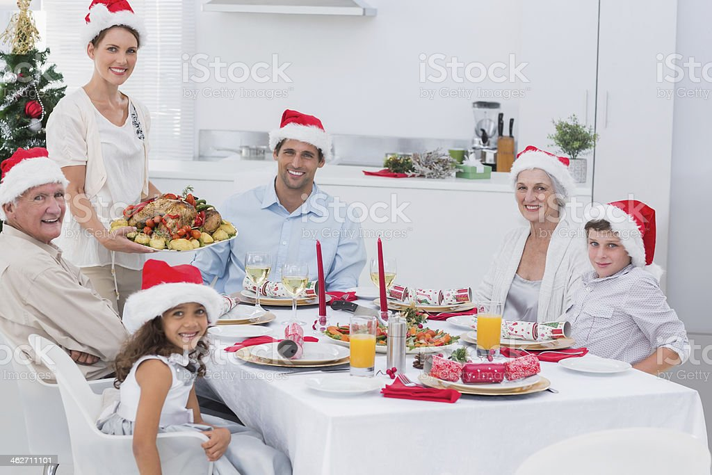 Woman bringing roast dinner at christmas royalty-free stock photo