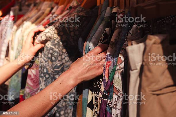 Woman browsing clothes at market picture id485039700?b=1&k=6&m=485039700&s=612x612&h= cb ssyhac2evg 1cpwcjwv1tciyiw6xrz4hrpk0tys=