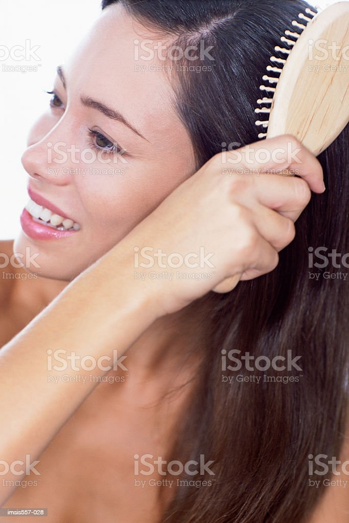 Woman brushing hair royalty-free stock photo