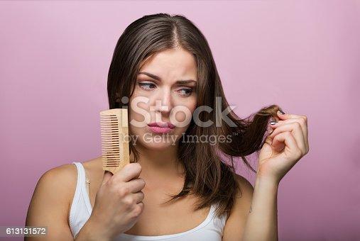 istock Woman brushing her hair 613131572
