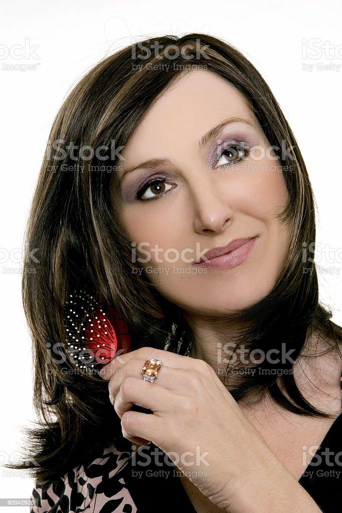 Woman brushing her hair royalty-free stock photo