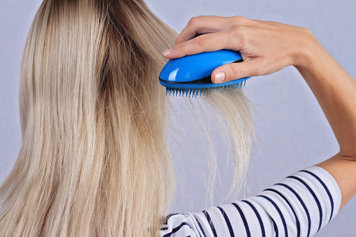 Woman Brushing Her Hair Thin Damaged Dry Hair Split Ends Stock Photo - Download Image Now