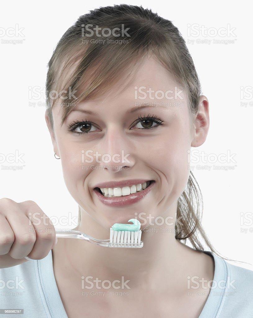 woman brushing her teeth royalty-free stock photo