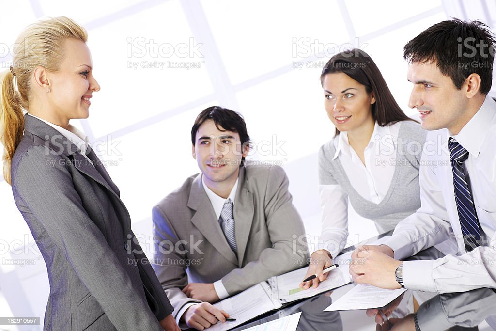 Woman business lieder working with team in office. royalty-free stock photo