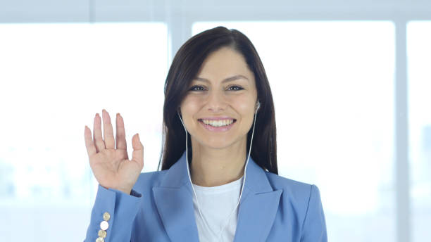 woman busy online video chat, waving hand - webcam stock photos and pictures