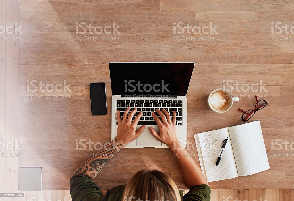 Woman busy working on laptop stock photo