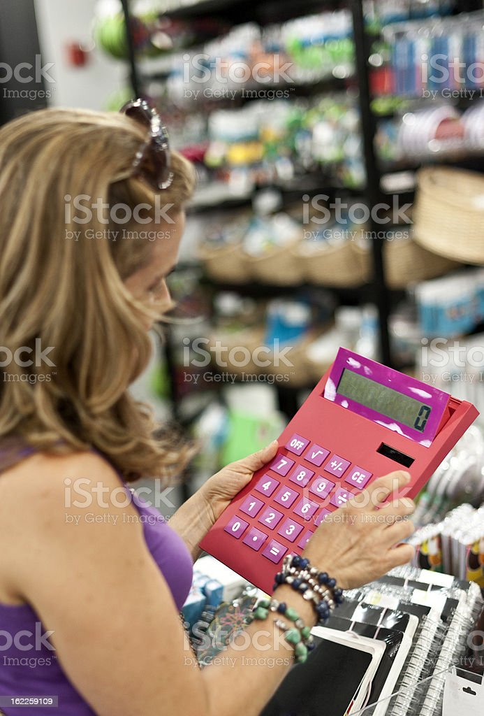 Woman buying a calculator stock photo