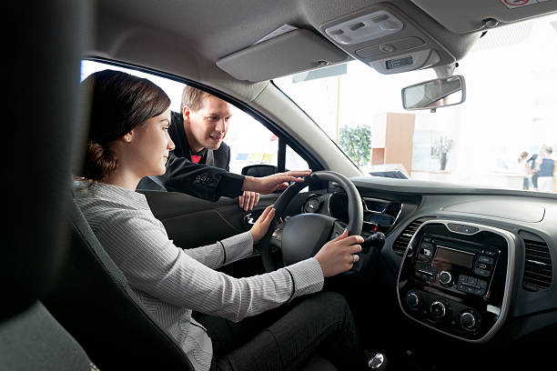 woman buying car from salesperson stock photo