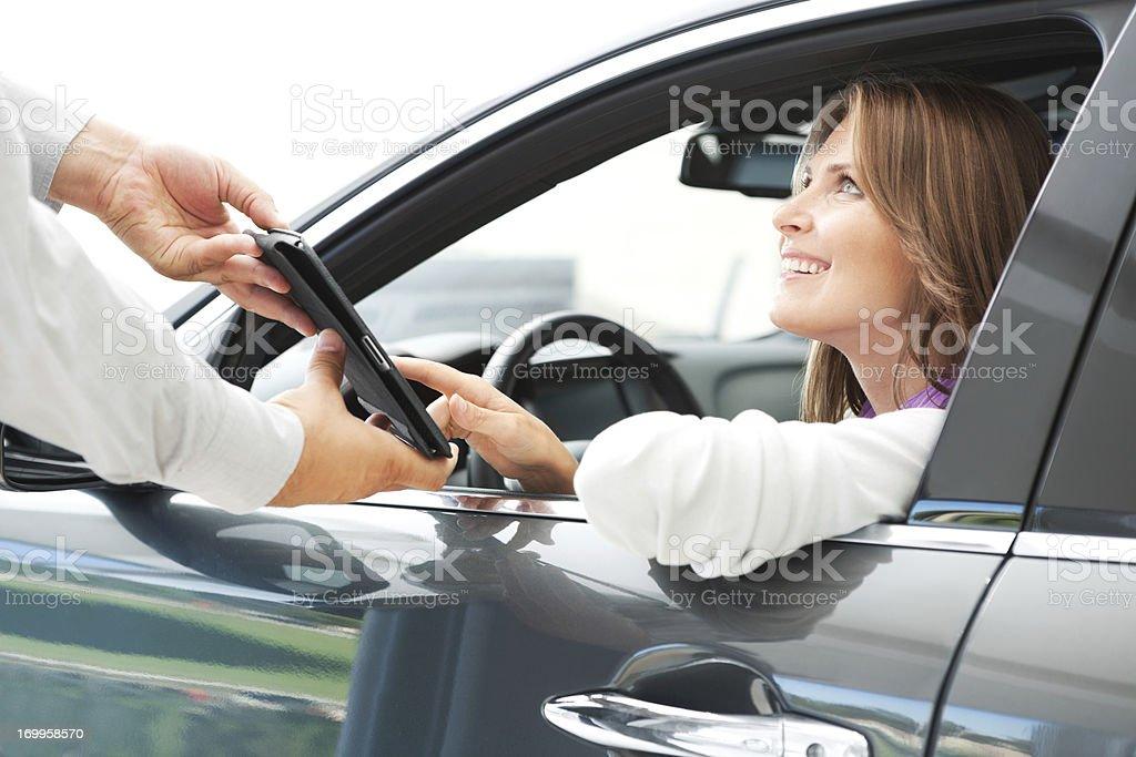 Woman buying car. stock photo