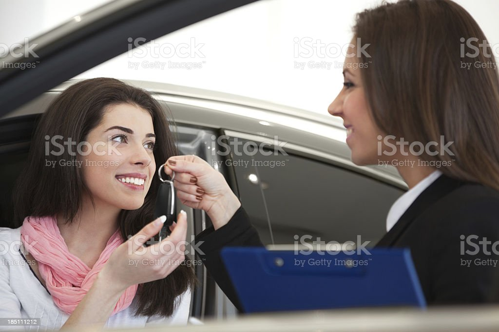 Woman buying car royalty-free stock photo