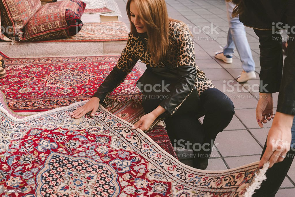 Woman Buying Carpets stock photo