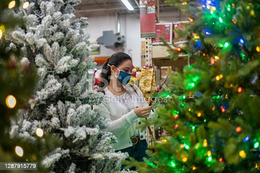 Woman buying Christmas tree during COVID