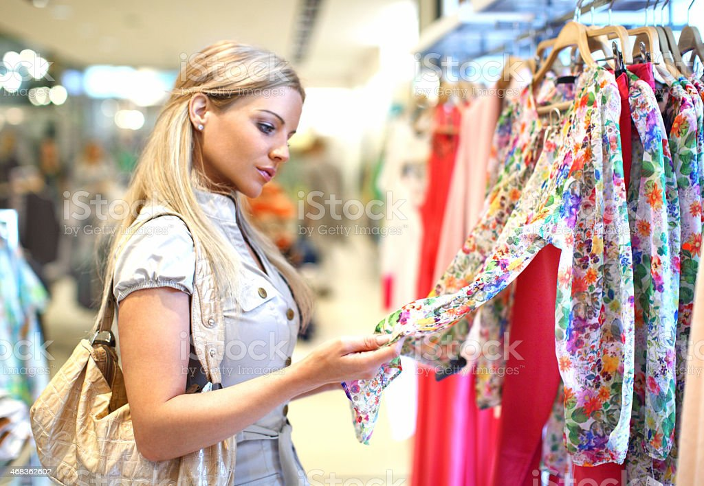 Woman buying clothes. royalty-free stock photo