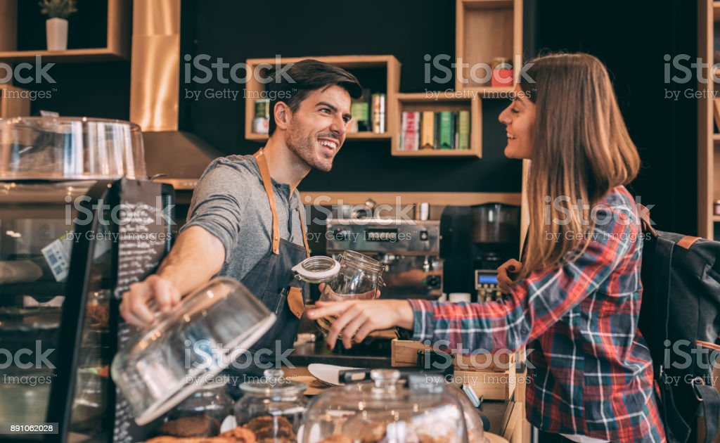 Woman buying cookies stock photo