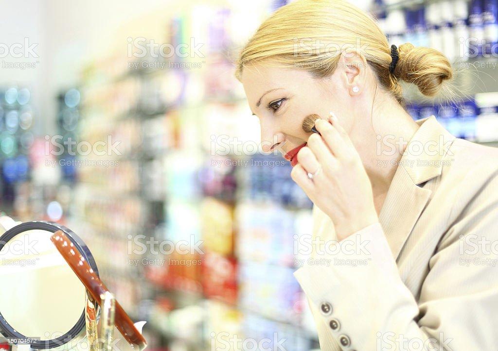 Woman buying cosmetics. royalty-free stock photo