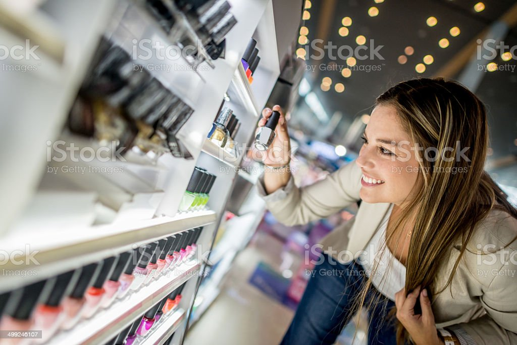 Woman buying cosmetics stock photo