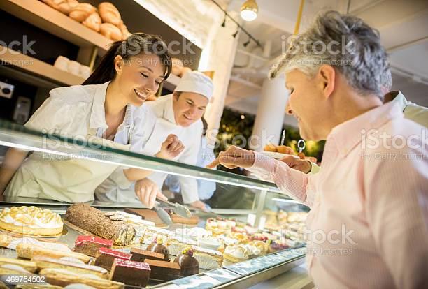 Woman buying desserts at a pastry shop picture id469754502?b=1&k=6&m=469754502&s=612x612&h=jqbmcei4tgc0iscqu8ytk3mtgj291pf8yhnx4g2bvii=