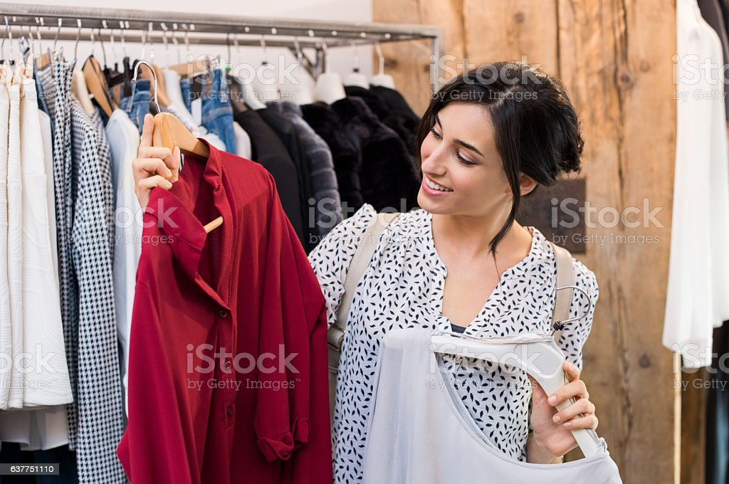 Woman buying dresses stock photo