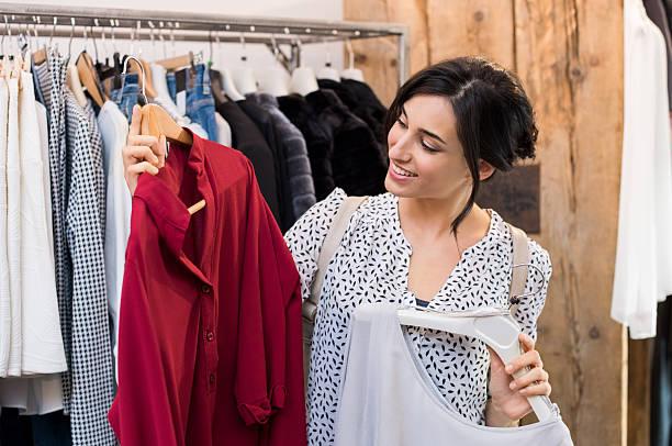 Woman buying dresses stock photo