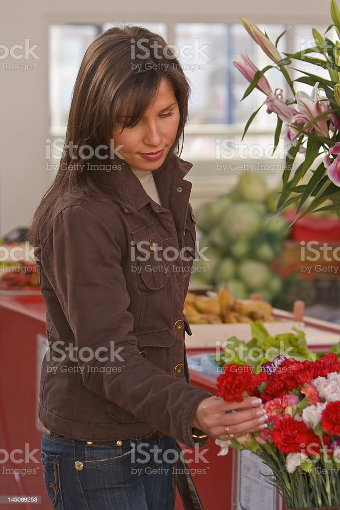 Woman buying flowers royalty-free stock photo