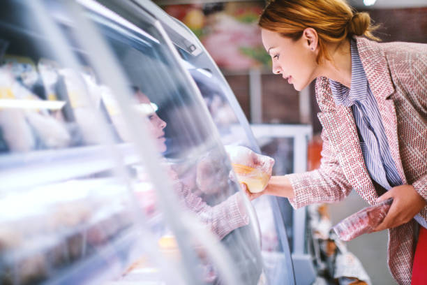 woman buying food at grocery store. - happy person buy appliances stock photos and pictures