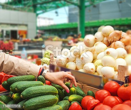 istock Woman buying fresh and organic fruits and vegetables at the green market or farmer agricultural market . 1149222315