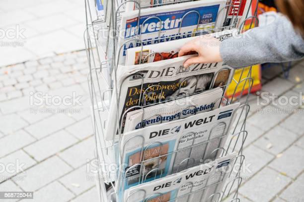 Woman buying german die zeit newspaper with angela merkel picture id868725044?b=1&k=6&m=868725044&s=612x612&h=x2obfcxk5w2i13jejizcsy93xl1yreu4vphoewm9lb0=