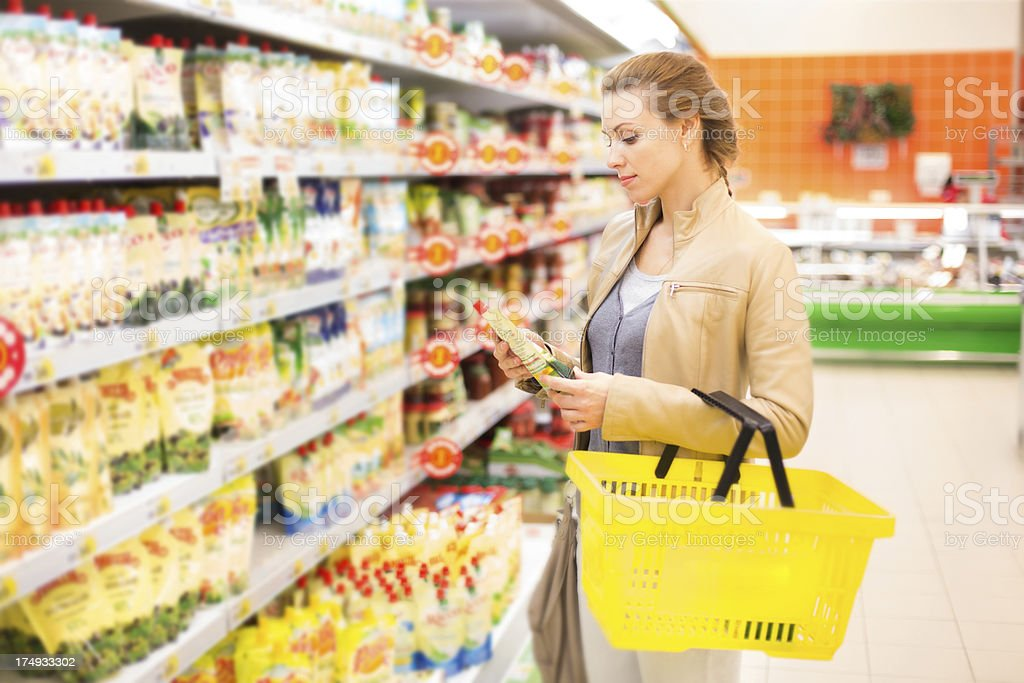 Woman buying groceries in a store royalty-free stock photo