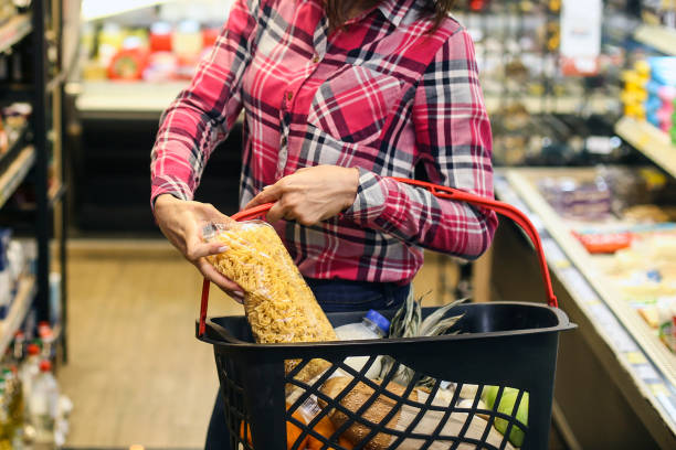 Woman buying groceries stock photo