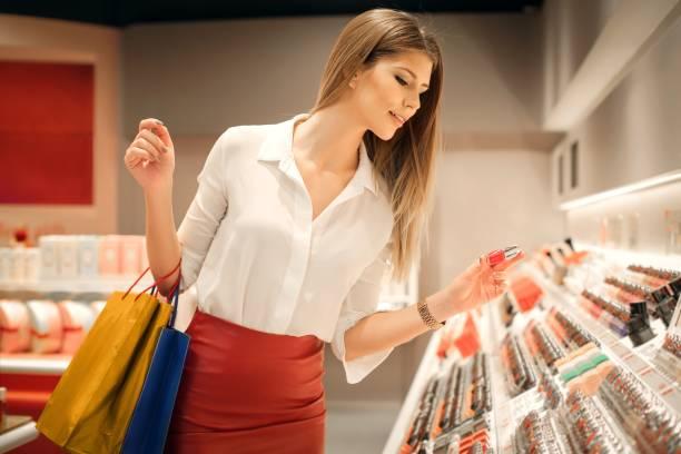 Woman buying her make-ups stock photo