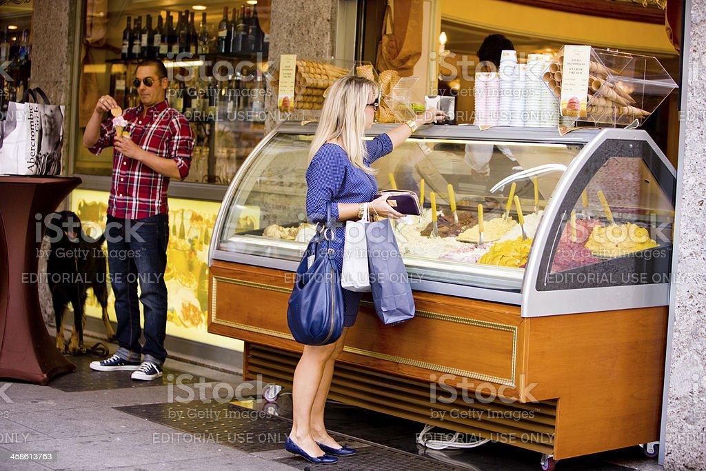 Woman buying ice cream, Milan, Italy stock photo