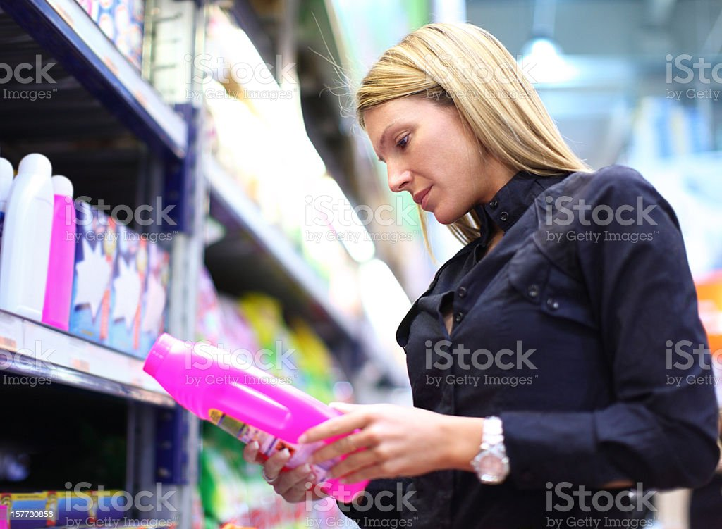 Woman buying laundry detergent. royalty-free stock photo