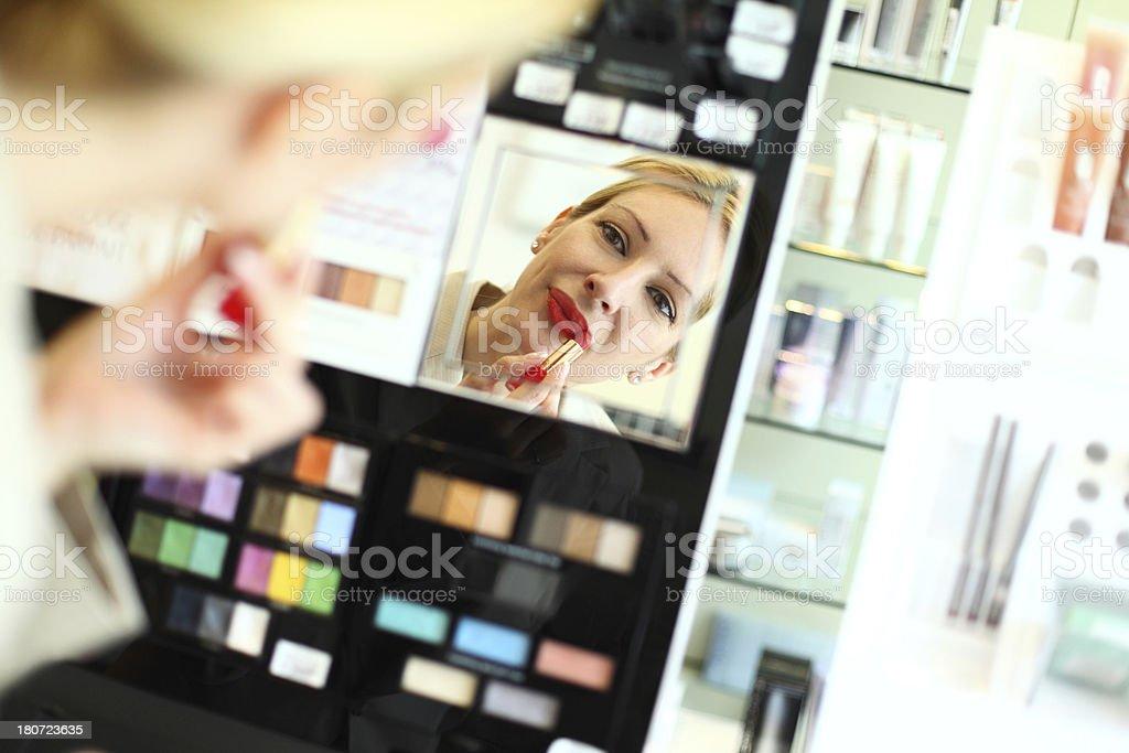 Woman buying lipstick. royalty-free stock photo