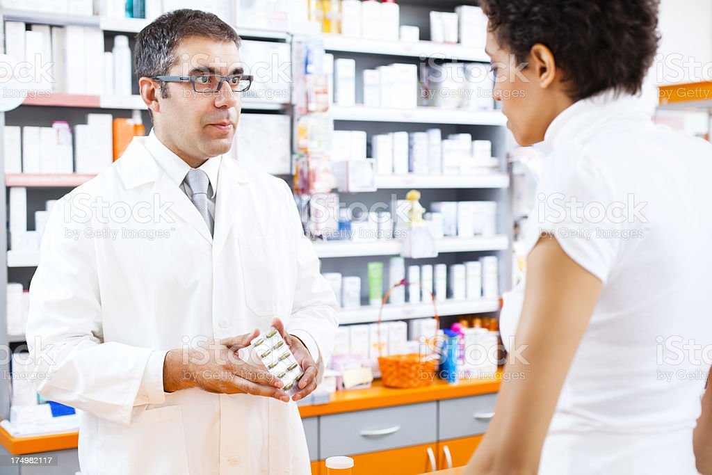 Woman buying medicine royalty-free stock photo