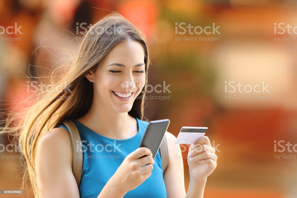 Woman buying on line on the street - foto stock