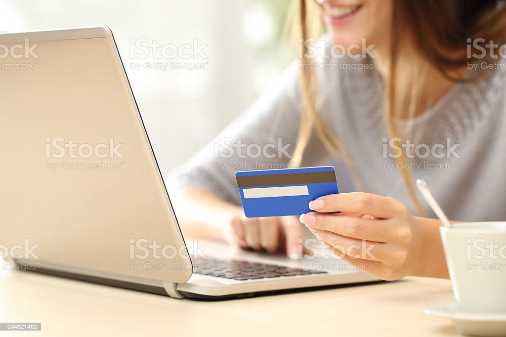 Woman buying online with credit card stock photo