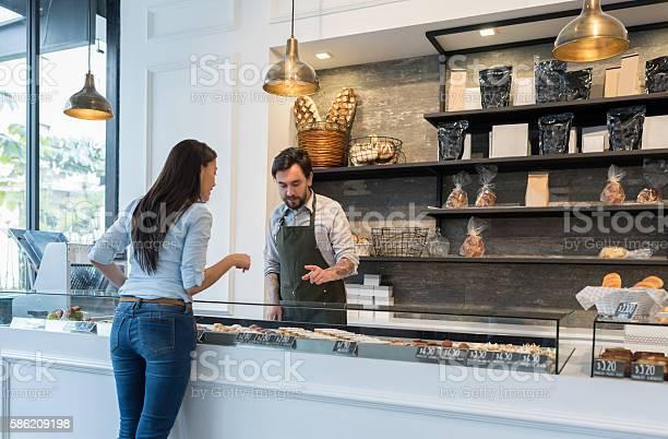 Woman buying pastries at a bakery picture id586209198?b=1&k=6&m=586209198&s=612x612&h=khd87ivgocgktjdota0qshhx036pbv9b p 8 tal1ay=