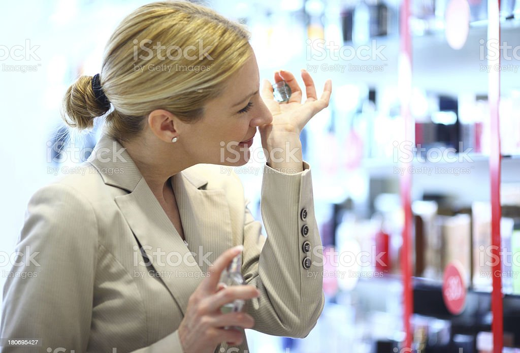 Woman buying perfume. royalty-free stock photo