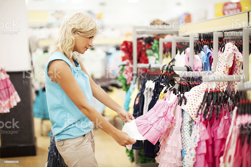 Woman buying pink dress. royalty-free stock photo