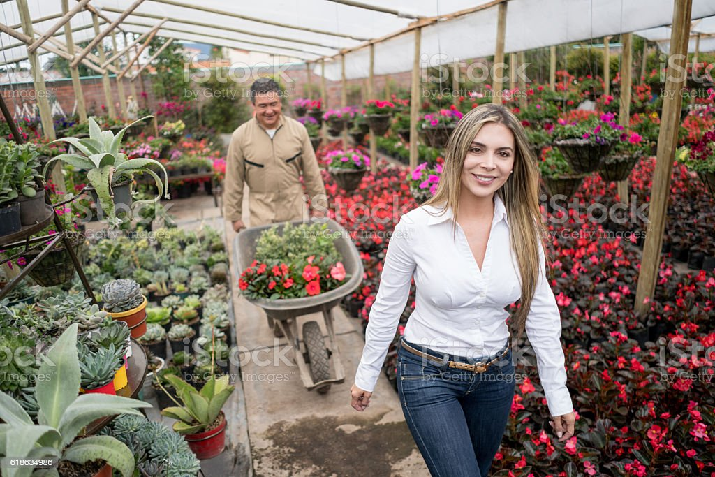 Woman buying plants at a graden center stock photo