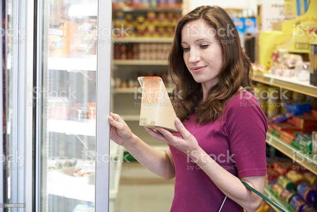 Woman Buying Sandwich From Supermarket stock photo