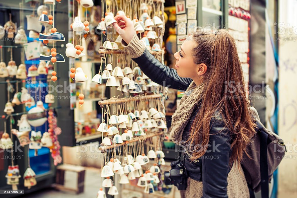 Woman buying souvenirs stock photo