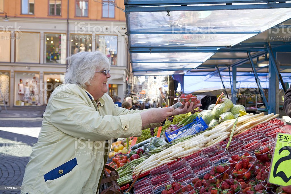 Woman buying strawberries royalty-free stock photo