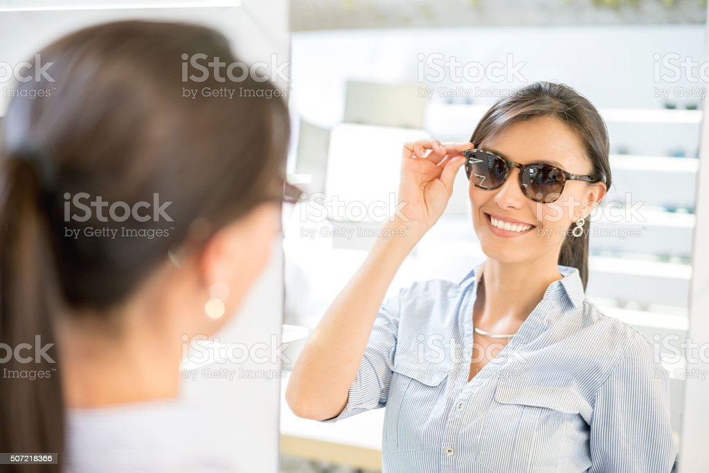 Woman buying sunglasses at the optician's shop stock photo