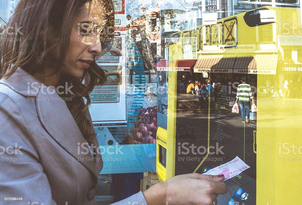 Woman Buying Ticket For Public Transportation, Istanbul, Turkey stock photo