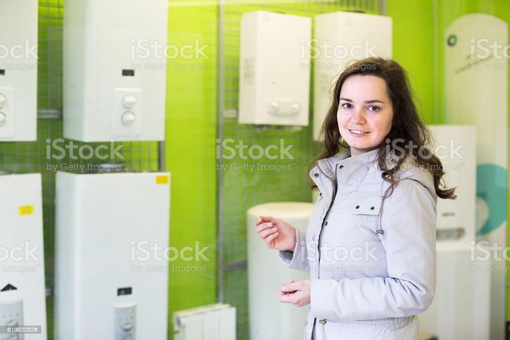 woman buying  water boiler stock photo
